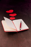 Writing about love in notebook Royalty Free Stock Images