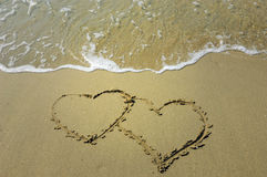 Writing love symbol. On the sand at a sea royalty free stock image