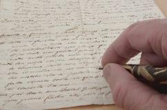 Writing a manuscript Royalty Free Stock Photo