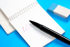 Writing material. A small notepad with black pencil. Besides a rubber royalty free stock photo