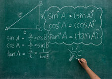 Writing the mathematics formulas on a blackboard Royalty Free Stock Images