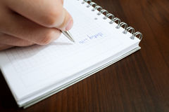 Writing meeting message. On white notepad closeup Royalty Free Stock Photos