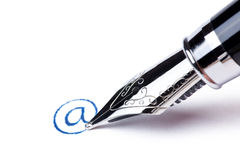 Writing message with pen : at Royalty Free Stock Image