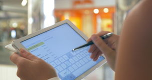 Writing Message in Tablet with Stylus stock footage