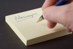 Writing Messages. Message pad with somebody writing on it Stock Photos