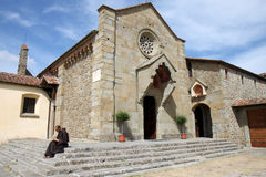 Writing monk near Convento di San Francesco, Italy. Writing Franciscan Brother at the stairs of the Convento di San Francesco in the Italian town of Fiesole stock photography