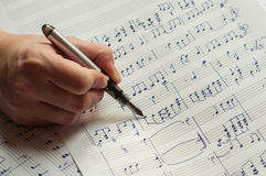 Writing music notes with fountain pen Royalty Free Stock Photos