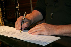 Writing musical notes. Musician that write musical notes Royalty Free Stock Photo