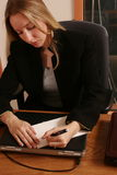Writing a note. Business woman writing a note Royalty Free Stock Photography