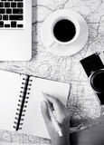 Writing note on map with accessories black and white design Stock Photography