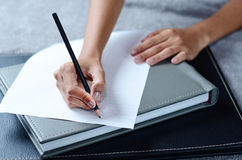 Writing a note. On paper Stock Photography
