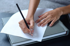 Writing a note. On paper Royalty Free Stock Photography