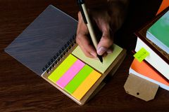 Writing note with pen and books props Royalty Free Stock Image