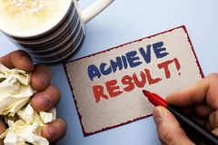 Writing note showing  Achieve Result Motivational Call. Business photo showcasing Obtain Success Reaching your goals written by Ma. N Cardboard Piece Holding Royalty Free Stock Photography