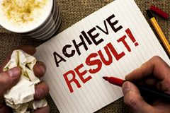 Writing note showing  Achieve Result Motivational Call. Business photo showcasing Obtain Success Reaching your goals written by Ma. N Holding Marker Notebook Royalty Free Stock Photo
