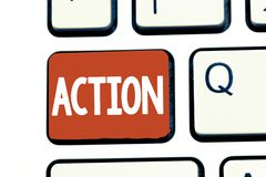 Writing note showing Action. Business photo showcasing fact or process doing something typically to achieve aim goal.  stock photos
