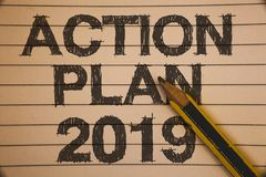 Writing note showing Action Plan 2019. Business photo showcasing Challenge Ideas Goals for New Year Motivation to Start Ideas con. Cepts on old beige notebook stock photography