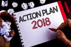 Writing note showing  Action Plan 2018. Business photo showcasing Plans targets activities life goals improvement development writ. Ten by Man Notepad holding Stock Images
