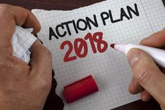 Writing note showing  Action Plan 2018. Business photo showcasing Plans targets activities life goals improvement development writ. Ten by Man Tear Notebook Stock Photography