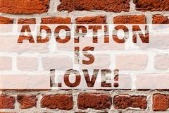 Writing note showing Adoption Is Love. Business photo showcasing action or fact of adopting or being adopted is kind royalty free stock photo