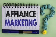 Writing note showing  Affiance Marketing. Business photo showcasing joining two or more companies in same field mutual goal writte. N Notebook the plain Royalty Free Stock Photo