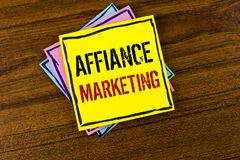 Writing note showing  Affiance Marketing. Business photo showcasing joining two or more companies in same field mutual goal writte. N Yellow Sticky Note Paper Stock Images