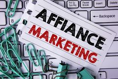 Writing note showing  Affiance Marketing. Business photo showcasing joining two or more companies in same field mutual goal writte. N Tear Notepad paper placed Royalty Free Stock Photo
