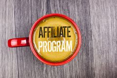 Writing note showing Affiliate Program. Business photo showcasing software link songs apps books and sell them to earn money writ. Ten Coffee in Red Cup the Grey royalty free stock photo