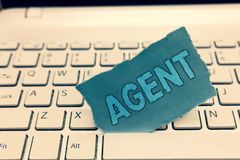 Writing note showing Agent. Business photo showcasing Person manages contractual matter Organize transaction between stock photography
