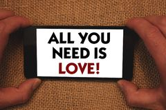 Writing note showing All You Need Is Love Motivational. Business photo showcasing Deep affection needs appreciation romance Man h royalty free stock photos