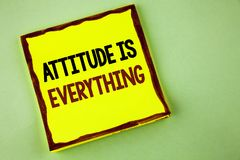 Writing note showing  Attitude Is Everything. Business photo showcasing Motivation Inspiration Optimism important to succeed writt. En Yellow Sticky note paper Royalty Free Stock Photo