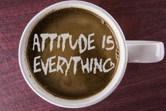 Writing note showing  Attitude Is Everything. Business photo showcasing Motivation Inspiration Optimism important to succeed writt. En Coffee in white Cup the Royalty Free Stock Photography