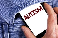 Writing note showing  Autism. Business photo showcasing Autism Awareness conducted by social committee around the globe written on. Writing note showing  Autism Stock Images
