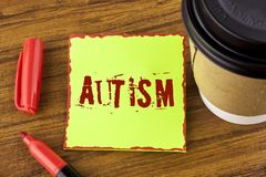 Writing note showing  Autism. Business photo showcasing Autism Awareness conducted by social committee around the globe written on. Writing note showing  Autism Stock Photo