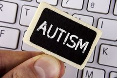 Writing note showing  Autism. Business photo showcasing Autism Awareness conducted by social committee around the globe written on. Writing note showing  Autism Stock Image
