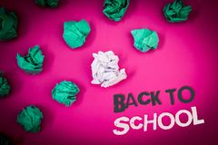 Writing note showing Back To School. Business photo showcasing Return to class first day of studies Classroom Arriving Text Words. Pink background crumbled stock photo