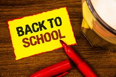 Writing note showing Back To School. Business photo showcasing Return to class first day of studies Classroom Arriving Words yell. Ow paper note red border open royalty free stock image