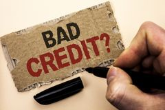 Writing note showing  Bad Credit Question. Business photo showcasing Low Credit Finance Economic Budget Asking Questionaire writte. N by Man Holding Marker tear Stock Photography