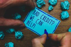 Writing note showing Bad Credit question We Can Help. Business photo showcasing Borrower with high risk Debts Financial Foggy hand. Hold marker drawn blue stock images