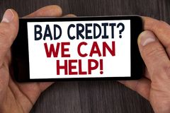 Writing note showing Bad Credit Question We Can Help Motivational Call. Business photo showcasing achieve good debt health writte. N Mobile Phone Screen holding royalty free stock images