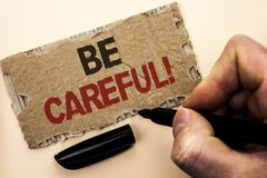 Writing note showing  Be Careful. Business photo showcasing Caution Warning Attention Notice Care Beware Safety Security written b. Y Man Holding Marker tear Stock Images