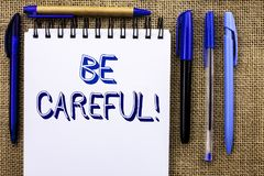 Writing note showing Be Careful. Business photo showcasing Caution Warning Attention Notice Care Beware Safety Security written o royalty free stock images
