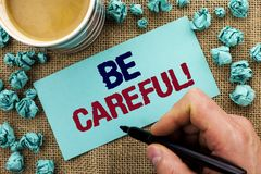 Writing note showing Be Careful. Business photo showcasing Caution Warning Attention Notice Care Beware Safety Security written b royalty free stock photography