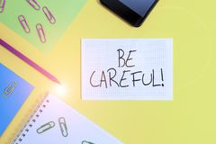 Free Writing Note Showing Be Careful. Business Photo Showcasing Making Sure Of Avoiding Potential Danger Mishap Or Harm Paper Sheets Royalty Free Stock Photography - 162194127