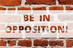 Writing note showing Be In Opposition. Business photo showcasing in contrast or conflict with group of showing or idea. Brick Wall art like Graffiti stock images