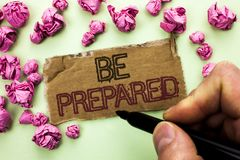 Writing note showing  Be Prepared. Business photo showcasing Preparedness Challenge Opportunity Prepare Plan Management written by. Man Holding Marker Tear Stock Image