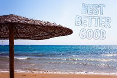 Writing note showing Best Better Good. Business photo showcasing improve yourself Choosing best choice Deciding Improvement Blue. Beach sand message idea royalty free stock photo