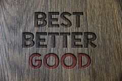 Writing note showing Best Better Good. Business photo showcasing improve yourself Choosing best choice Deciding Improvement Woode. N wood background black stock images