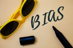 Writing note showing Bias. Business photo showcasing Unfair Subjective One-sidedness Preconception Inequality Bigotry Ideas messa. Ges beige background black stock image