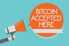 Writing note showing Bitcoin Accepted Here. Business photo showcasing you can purchase things through Cryptocurrencies Attention w. Arning hot social issue Royalty Free Stock Image